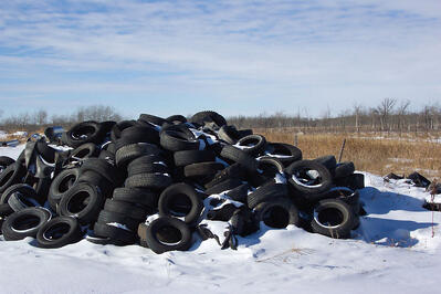 Pile of tires covered in Snow